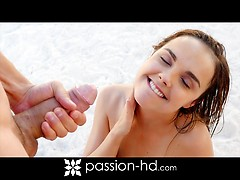 Hot young surfer girl is offered a massage from a handsome stranger at he beach.